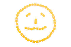 Sad or upset face made of pills Royalty Free Stock Images