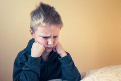 Sad upset tired boy. Sad upset tired worried unhappy kid (boy, teen) close up portrait with copy space Royalty Free Stock Photo