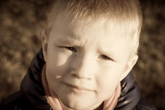 Sad upset unhappy little child (boy). Sad upset tired worried unhappy little child (boy) close up horizontal, expressive eyes Stock Images