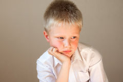Sad upset worried unhappy child Stock Photos