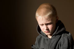 Sad upset worried unhappy little child (boy) Royalty Free Stock Photography