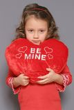 Sad Valentine. A little girl looking serious for Valentines day royalty free stock image