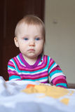 Sad and very serious baby girl Stock Photo