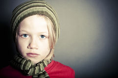 Sad victim of abuse. Concept of a young boy who is the victim of abuse Royalty Free Stock Photography