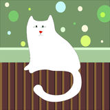Sad white cat sitting on the floor in the room. A puffy, slender and fat cat sitting on the floor in a room near the wall with wallpaper and plinth Royalty Free Stock Images