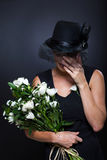 Widow crying funeral. Sad widow crying at husband's funeral Royalty Free Stock Photos