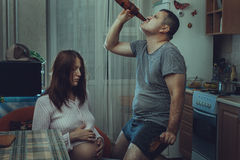 Sad wife, husband is an alcoholic. Stock Photo
