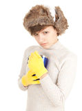 Sad winter girl keeping big blue cup Stock Images