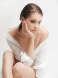 Sad woman. Studio portrait sad woman on a white background Stock Image