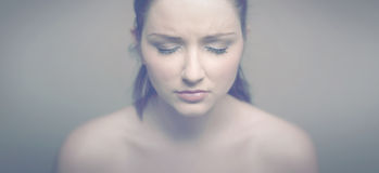 Sad woman. A soft vintage panoramic portrait of a sad woman stock photo