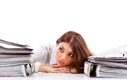 Sad woman. With ringbinders sitting at the desk Royalty Free Stock Photography