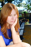 Sad woman. Mature woman looking sad and depressed sitting alone on a park bench Royalty Free Stock Photos