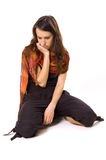 Sad woman. Sitting on the floor Stock Photography