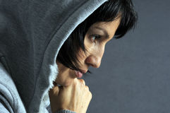 Sad woman. Over gray backgroung royalty free stock photo
