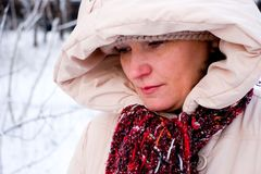 Sad woman. The sad woman portrait in winter nature background Royalty Free Stock Photos