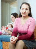 sad  woman against  daughter with baby Stock Photos