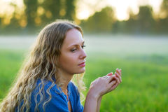 Sad beautiful fashion woman in a summer foggy field royalty free stock photo