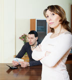 Sad woman against man with money Stock Photography