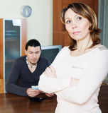 Sad woman against man with money Royalty Free Stock Images