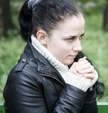 Sad woman. Alone sad woman in the park stock images