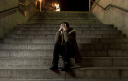 Sad woman alone on street subway staircase suffering depression looking looking sick and helpless Royalty Free Stock Image