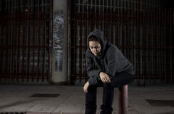 Sad woman alone on street suffering depression desperate and helpless wearing hoodie Stock Photography