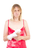 Sad woman with bandaged hand Stock Photography