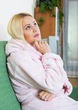Sad woman in bathrob Stock Images