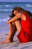 Sad woman on the beach Stock Image