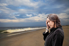 Sad Woman at the Beach Royalty Free Stock Image