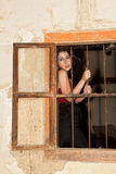 Sad woman behind bars Royalty Free Stock Photography