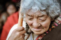 Sad woman in Bihar. Bohdgaya, Bihar - circa January 2012: Old woman with grey hair holds wooden stick and looks down sadly in Bohdgaya, Bihar. Documentary Royalty Free Stock Image