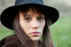 Sad woman with black hat stock images