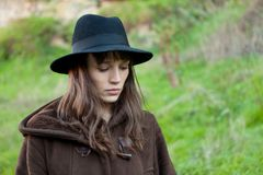 Sad woman with black hat royalty free stock image