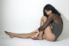 Sad woman in black sitting near Royalty Free Stock Photo