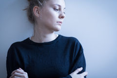 Sad woman in black sweater Royalty Free Stock Photography
