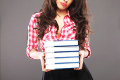 Sad woman with books Royalty Free Stock Image