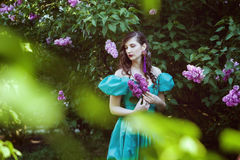 Sad woman with a branch of lilac. Royalty Free Stock Photo