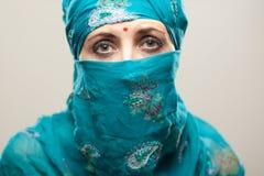 Sad woman in burga. Mature woman in Burqa on gray background with beautiful makeup Royalty Free Stock Photo