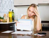 Sad woman calculating family budget Royalty Free Stock Photos
