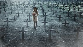 Sad woman in the cemetery . Stock Photo