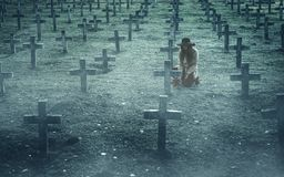 Sad woman in the cemetery . Royalty Free Stock Image