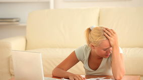 Sad woman checking her expenses Stock Photography