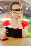 Sad Woman Checking Restaurant Bill Stock Photo