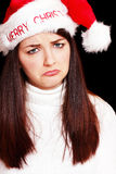 Sad woman in christmas hat Stock Photo