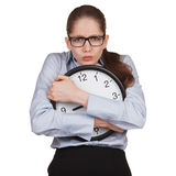 Sad woman with clock in hands Stock Photo