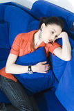 Sad woman on couch Royalty Free Stock Image
