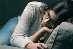 Sad woman on the couch at home Royalty Free Stock Photography