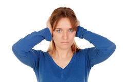 Sad woman covering her ears Royalty Free Stock Photography