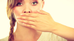 Sad woman covering mouth with hand Stock Images
